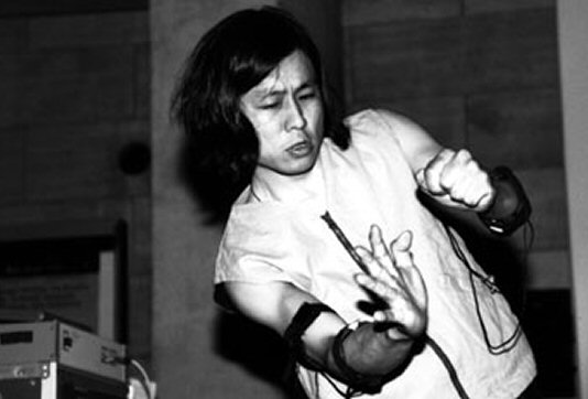 Atau Tanaka performing at the Sonar Festival, Barcelona, Spain, June 1997.